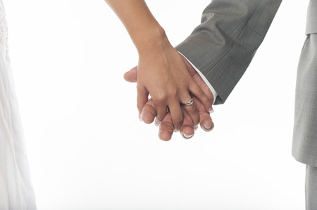 marrying: Bride and groom holding hands