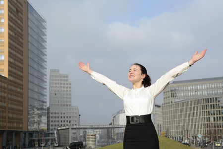 blouses: Cheering business woman enjoying sun, Berlin,Gdermany