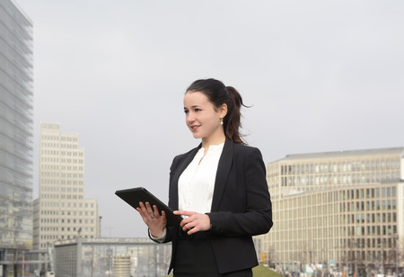 Successful young business woman using digital tablet, Berlin, Germany Stock Photo