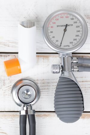 blood pressure gauge: Asthma spray, blood pressure gauge and stethoscope Stock Photo