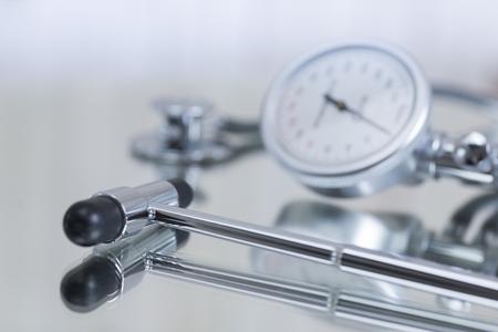reflex: Blood pressure gauge and stethoscope and reflex hammer
