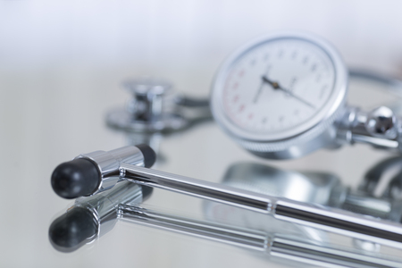Blood pressure gauge and stethoscope and reflex hammer