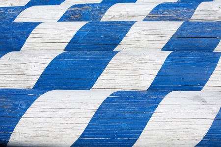 sawed: Sawed may pole with blue and white pattern Stock Photo