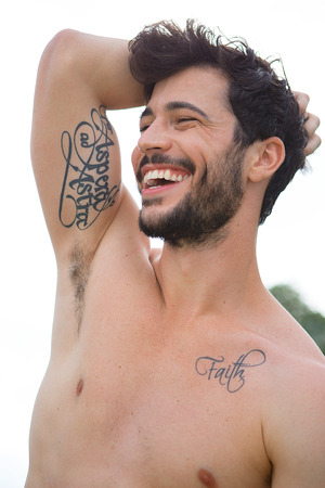 tatoos: Portrait of man with bare chest and tatoos Stock Photo