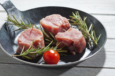 lusty: Bacon wrapped pork fillet with tomatoes in pan
