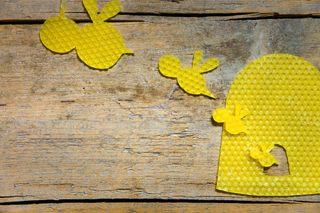 Beeswax, bees and beehive on wood