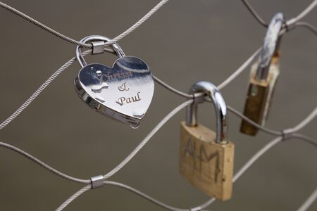 wire fence: Love locks on wire fence Editorial