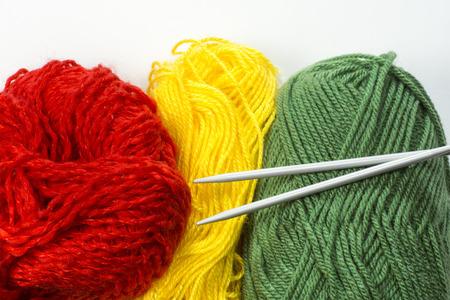 knitting needles: Balls of wool with knitting needles