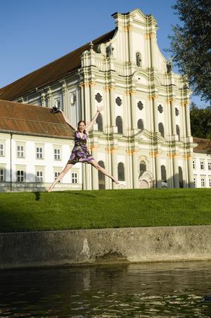 in bavaria: Germany, Bavaria, Upper Bavaria, Young woman cutting a caper