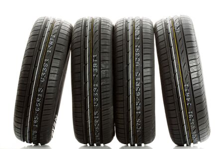New car tires against white background photo