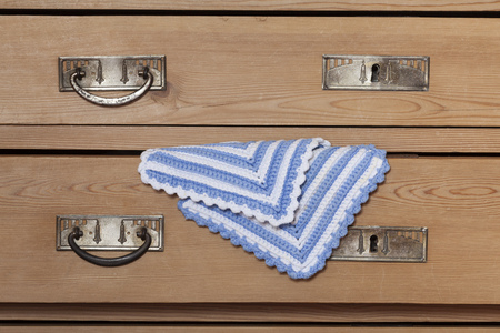 drawers: Wood drawers of old chest of drawers and crocheted potholders