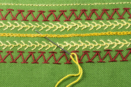 sewing needle: Embroidery, sewing needle, green linen Stock Photo