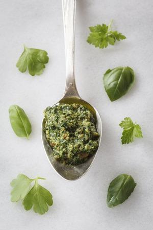 Spoon with vegan parsley basil pesto