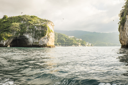water birds: Pacific islands of Los Arcos National Marine Park, Banderas Bay, Mexico. About 10 miles South of Puerto Vallarta are several caved rocks that are breeding place for water birds like pelicans, herons and other species.