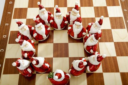 clauses: Group of Santa Clauses on chess board