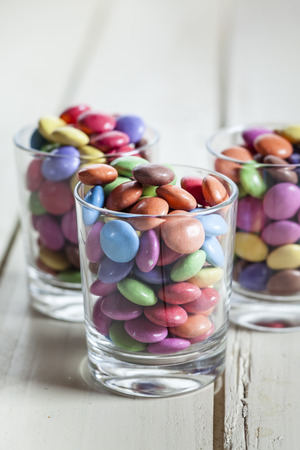 nibble: Colorful chocolate drops in glasses