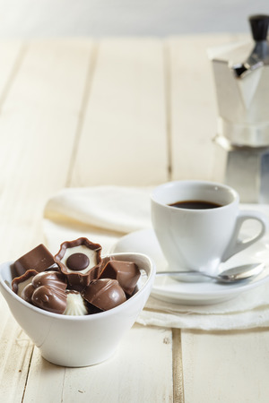 confectionary: Chocolate confectionary in bowl with Espresso coffee