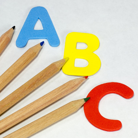 letter c: ABC letters and coloured pencils