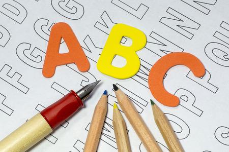 alphabet letter a: ABC letters, coloured pencils and pen on paper