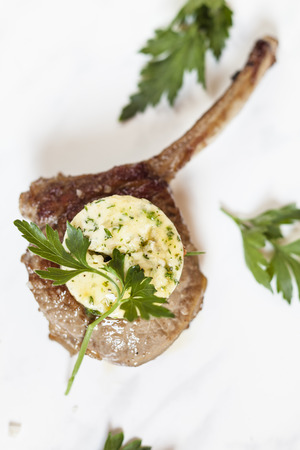lamb chop: Herb butter on lamb chop, parsley