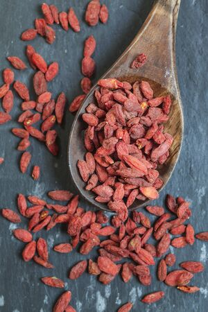 lycium: Goji berries on wooden spoon Stock Photo