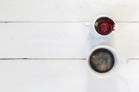 cofffee: Cup of cofffee and buttercup blossom on wood Stock Photo