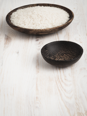unboiled: Unboiled rice distributed  in wooden bowls