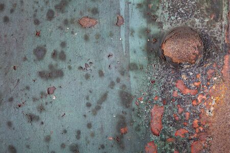 flaking: Rusting iron plate with flaking paint