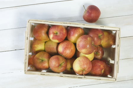 wooden crate: Red apples in wooden crate
