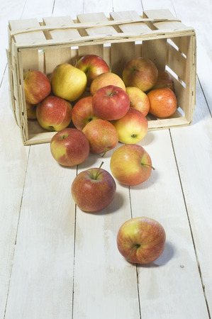 log basket: Red apples in wooden crate