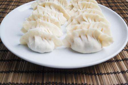 self made: Homemade Asian dumplings on a bamboo mat Stock Photo