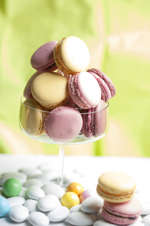 macarons: Macarons in glass, light green background