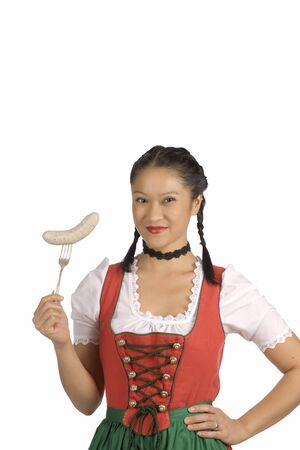 veal sausage: Asian woman wearing Dirndl holdin Bavarian veal sausage