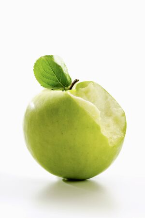 bitten: Bitten green apple Stock Photo