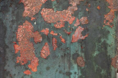 rusting: Rusting iron plate with flaking paint