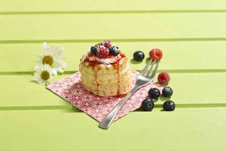 chartreuse: Puff pastries with vanilla-icecream and cream, blueberries and raspberries