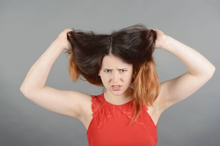 bad hair day: Young woman having a bad hair day