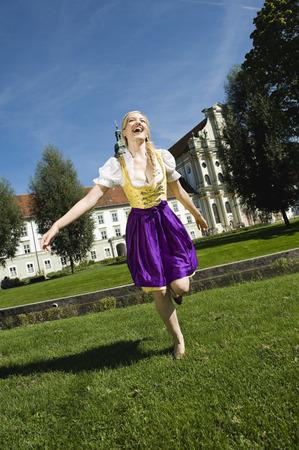 traditional costume: Germany, Bavaria, Upper Bavaria, Young woman in traditional costume, laughing