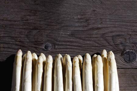 white asparagus: White asparagus, row, dark wood, copy space