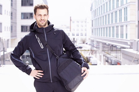 sports wear: Young man wearing sports wear and bag, Madgeburg, Germany Stock Photo