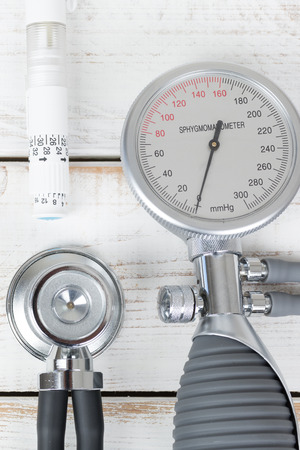 blood pressure gauge: Blood pressure gauge and stethoscope and insulin pen