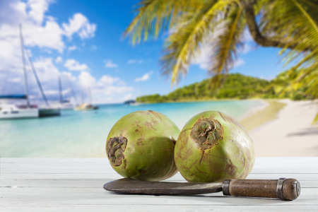 cleaver: Coconuts with cleaver on wood, Caribbean beach