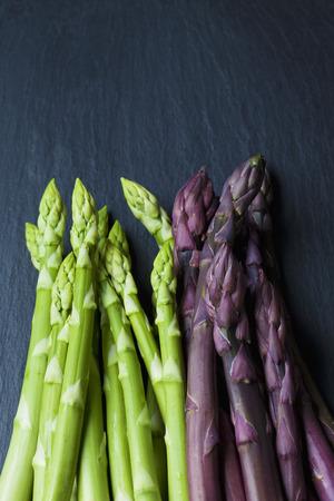 schist: Violet and green asparagus on slate