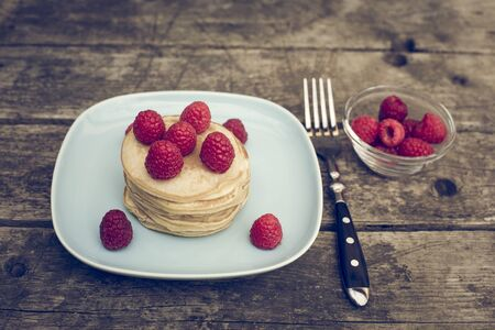 afters: Pancakes with raspberries on plate Stock Photo