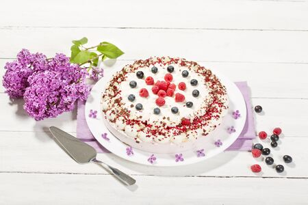 afters: Raspberry-cream cake with raspberries and blueberries