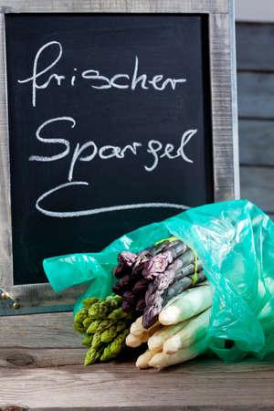 bunches: Different asparagus, green, purple, white, blackboard, fresh asparagus