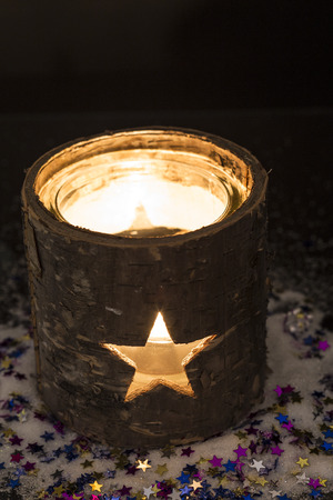 candle holder: Burning candle in tea light holder with stars Stock Photo
