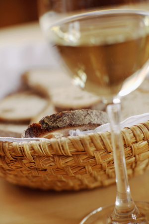 indulgence: Bread basket and glass of wine Stock Photo