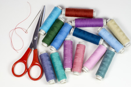 spermatophyte: Bobbins with colorful thread for tailoring with scissors an needle