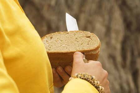 unrecognisable people: Austria, Salzburger Land, slicing bread Stock Photo